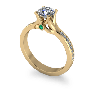 Sculptured yellow gold shank with emerald peak stone