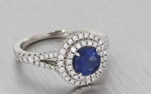 A Striking Sapphire And Diamond Double Halo Ring