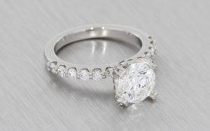 Round Brilliant Cut Engagement Ring With Diamond Shoulders - Portfolio