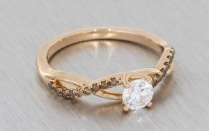 Warm Rose Gold And Cognac Diamond Ring With Entwined Ring Shank And White Diamond Centre Stone - Portfolio
