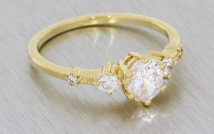 A Delicate Three Stone Engagement Ring Set Diamonds