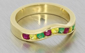 A Distinct Channel Set Ring Set With A Mouth Watering Mix Of Colourful Round Cut Stones
