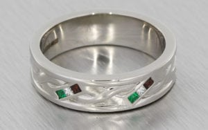 A Twisted Gents Band In Palladium Set With Square Cut Garnets, Emeralds And Diamonds