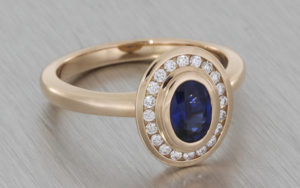 14ct rose gold ovel sapphire and diamond ring
