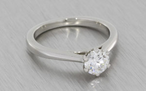 Platinum Round brilliant diamond ring with a matching diamond wedding band