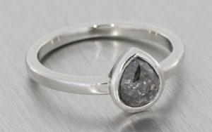 Platinum ring with a bezel set salt and pepper diamond