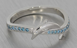 Platinum and blue diamond engagement ring