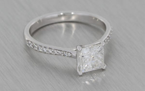 Platinum Princess cut diamond ring with diamond pave shoulders