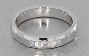 18ct white gold band set with invisible set round brilliant diamonds