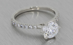 Classic platinum and diamond engagement ring with a personal twist