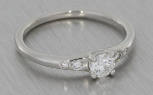 Contemporary platinum engagemenet ring set with brilliant cut white diamonds
