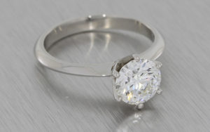 Platinum engagement ring set with a Crafted by Infinity diamond with a hidden emerald
