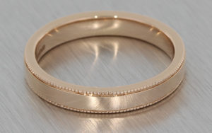 Rose gold wedding band with milgrain detailing