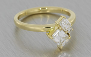 Contemporary three stone diamond ring