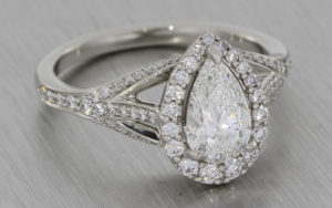 Ornate pear cut diamond halo engagement ring