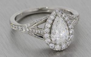 Ornate pear cut diamond halo engagement ring